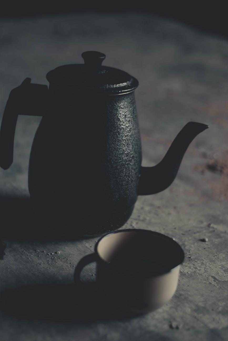A coffee pot and mug