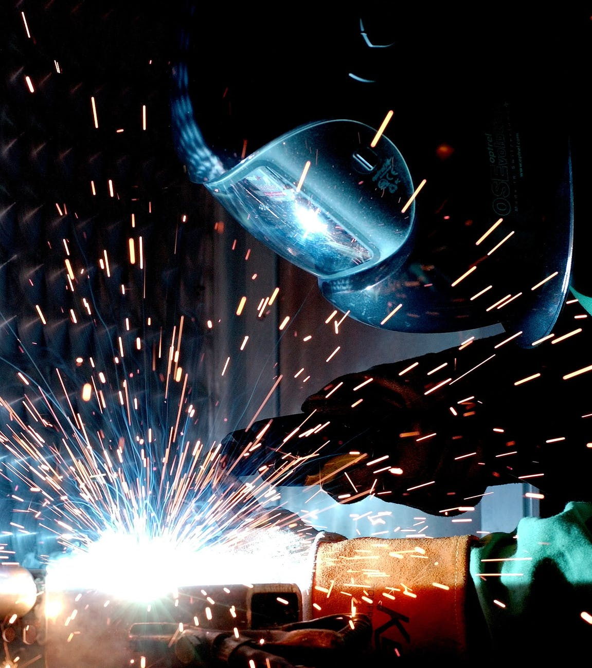 A welder surrounded by sparks